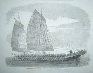 A large and long Chinese pirate junk from the 1850's, under oar and sail