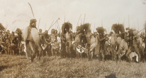 A senior induna calls to the men of his ibutho as they perform a ceremonial dance. IanKnightZulu.com