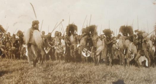A senior induna calls to the men of his ibutho as they perform a ceremonial dance. IanKnightZulu.com